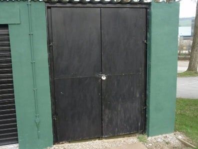 Old wooden lockup door