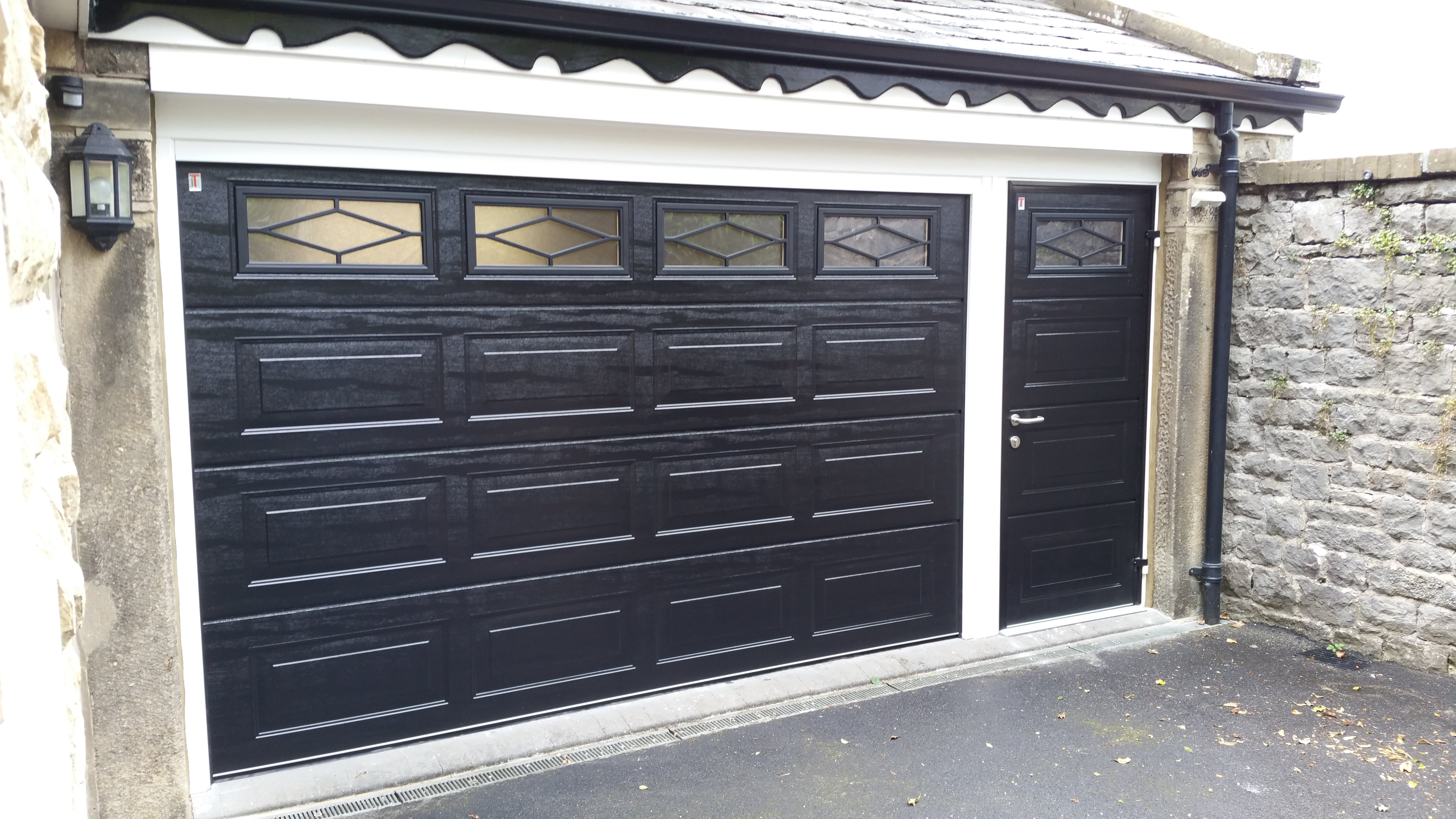 Garage doors sectional roller retractable canopy earby door window shutters and security systems from domestic roller shutters rubansaba